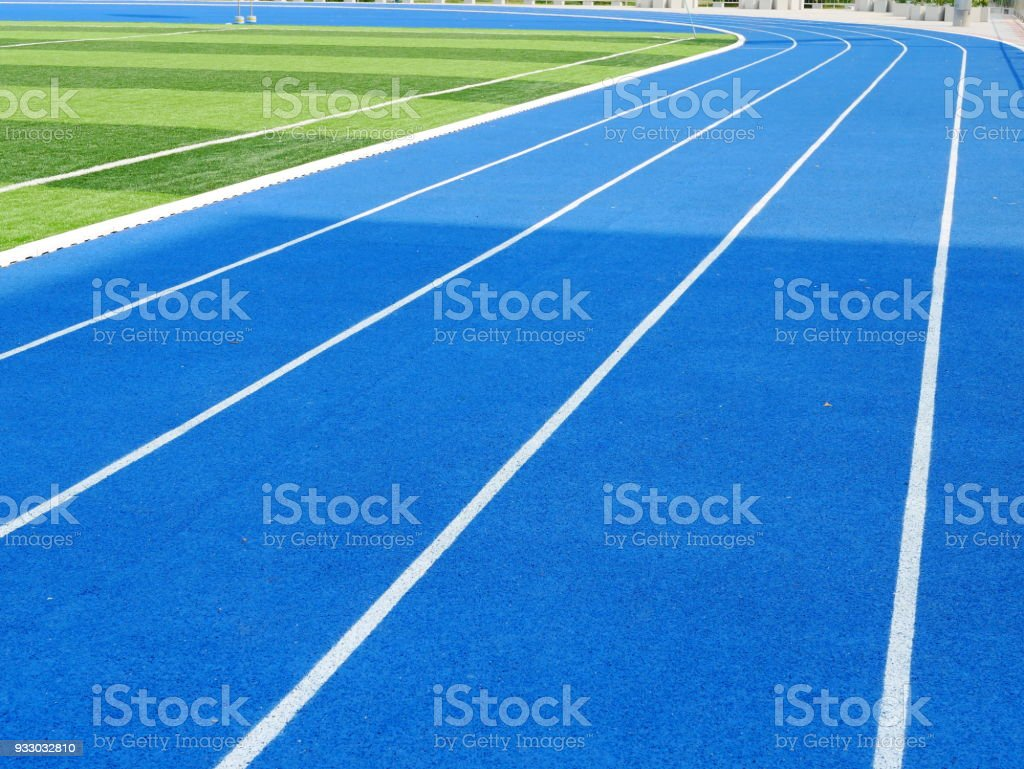 Blue running track stock photo