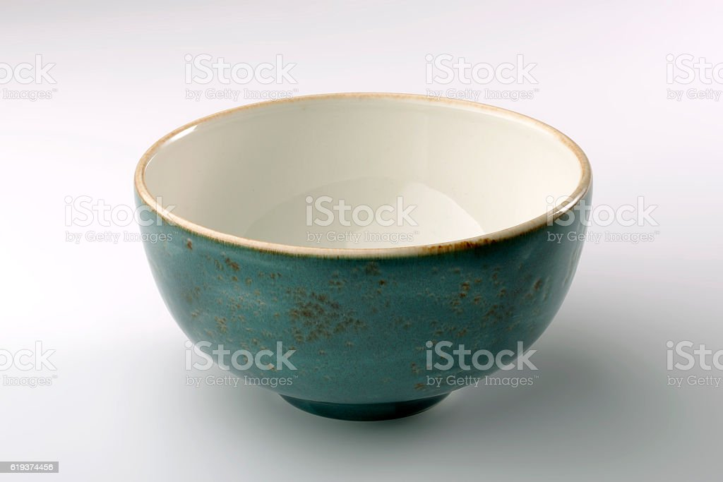 Blue rustic chinese bowl isolated on white background stock photo