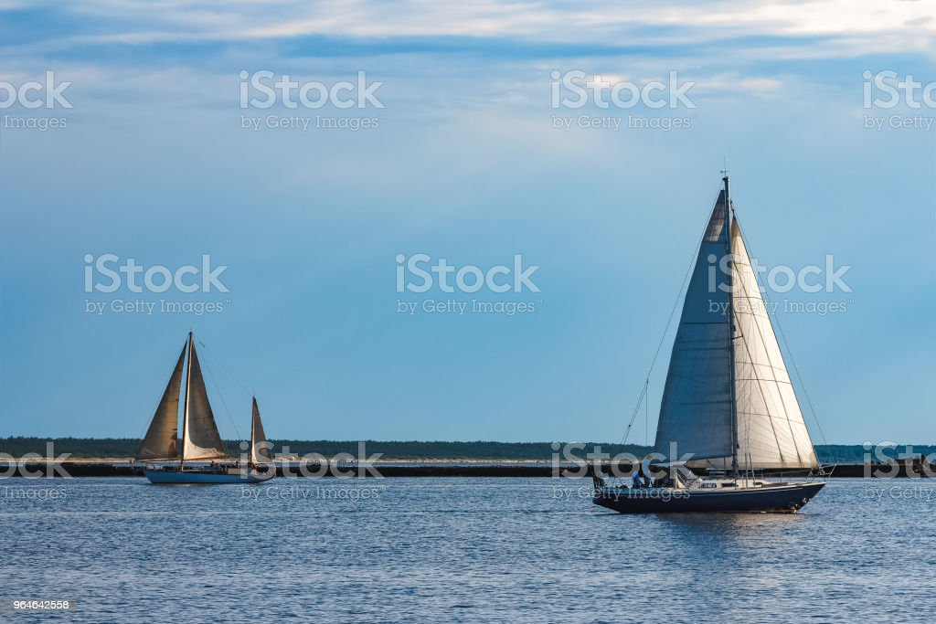 Blue sailboat at river royalty-free stock photo