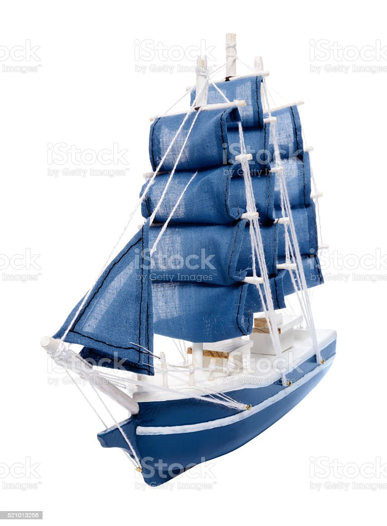 Blue sailboat with blue sails stock photo