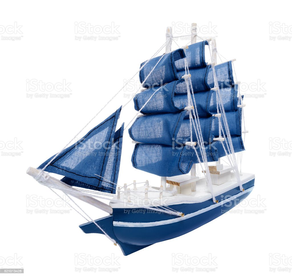 Blue sailboat with blue sails royalty-free stock photo