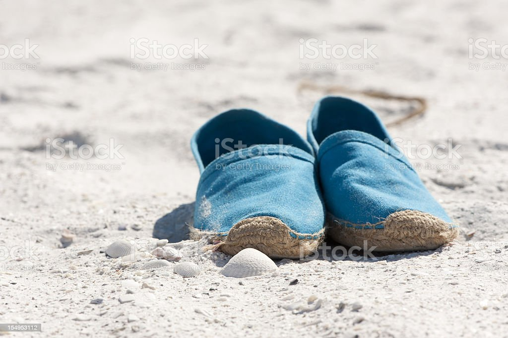 Blue sandals on the beach. stock photo