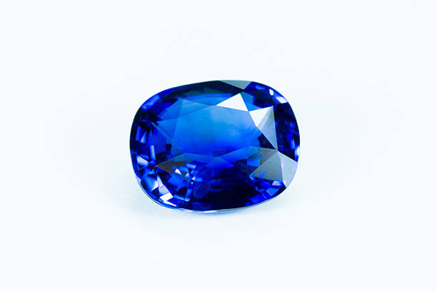 blue sapphire  isolated on white - dazzlingly stock pictures, royalty-free photos & images