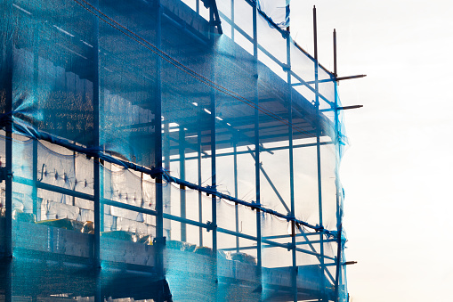 istock Blue scaffolding with safety netting 1070065278