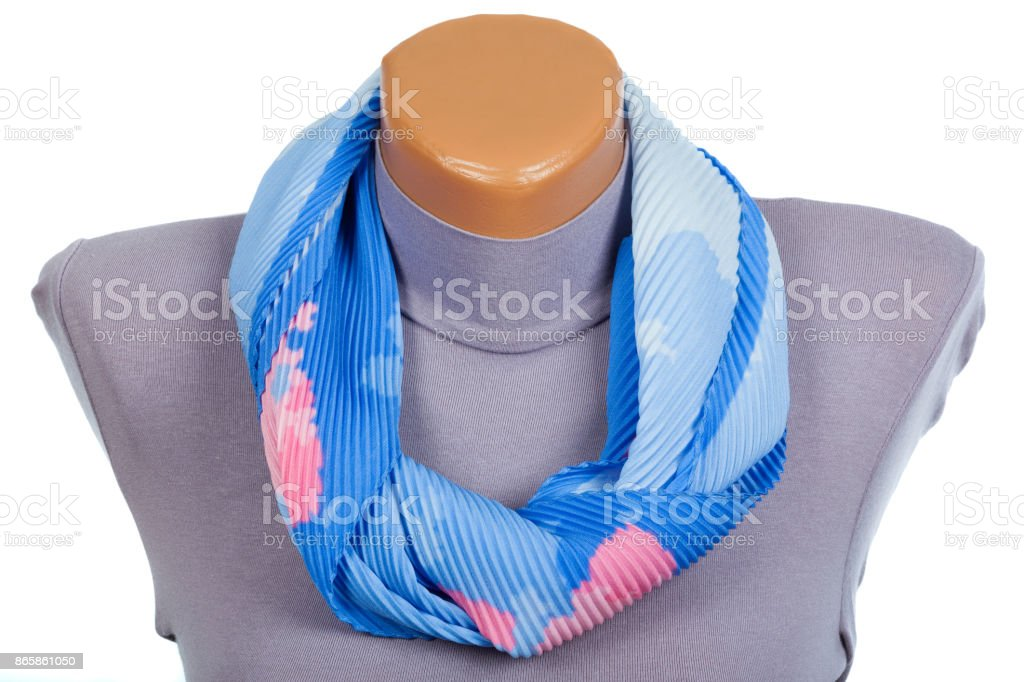 Blue scarf on mannequin isolated on white background. stock photo