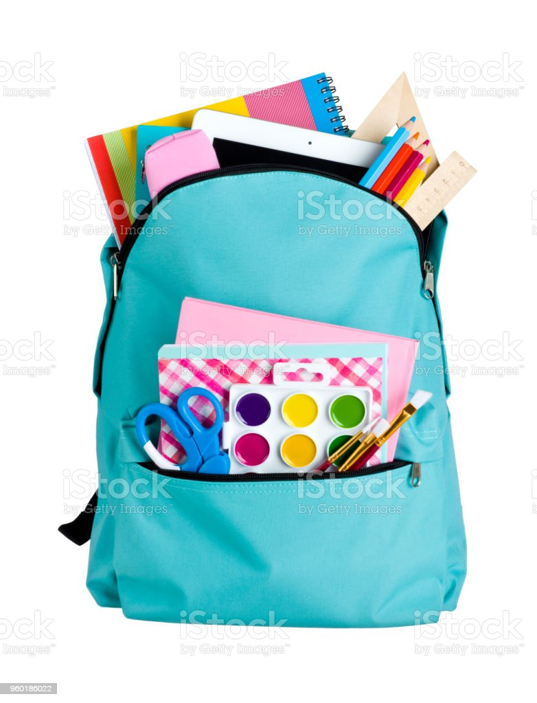 Blue school bag with school supplies isolated on white background stock photo