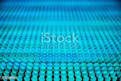 932724974 istock photo blue screen dots 1132539509