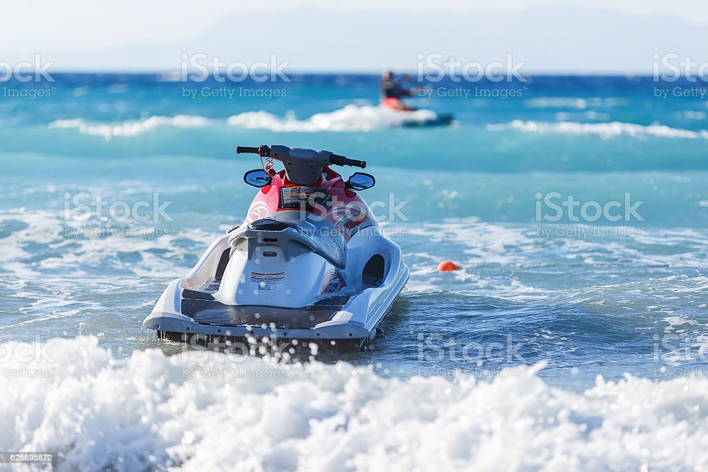 Blue sea and a jet ski floating on the , stock photo