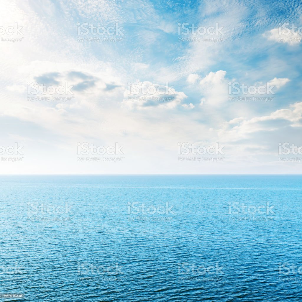 blue sea and clouds in sunset time stock photo
