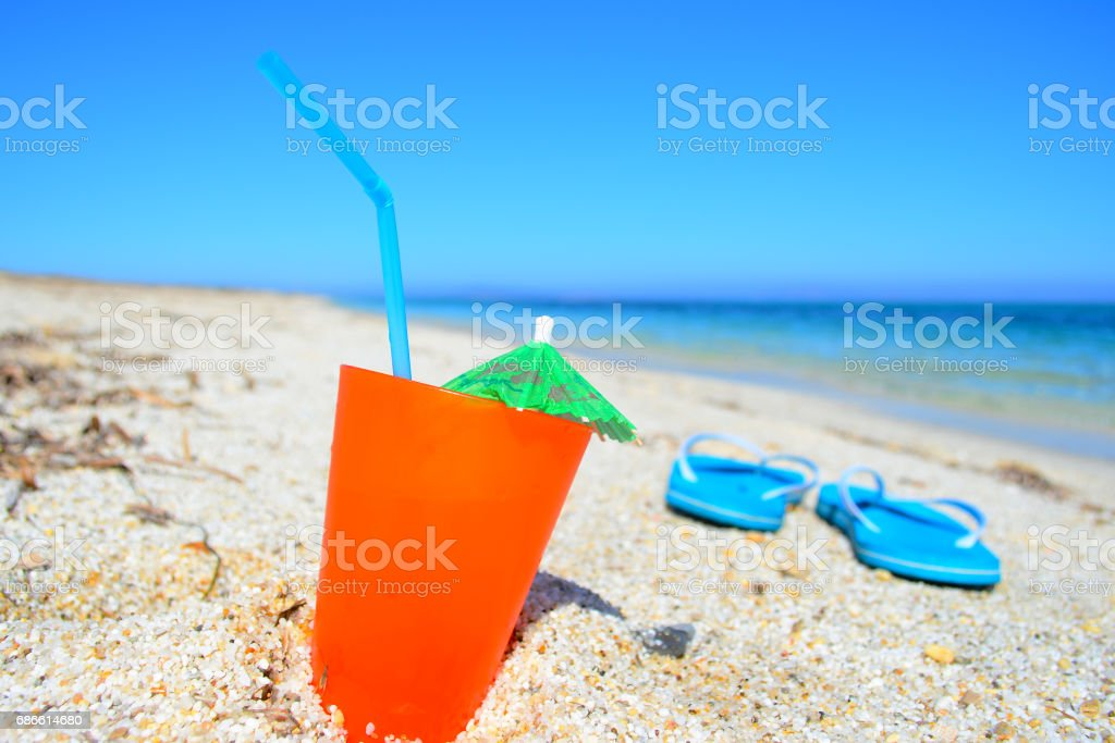 blue sea and orange drink royalty-free stock photo
