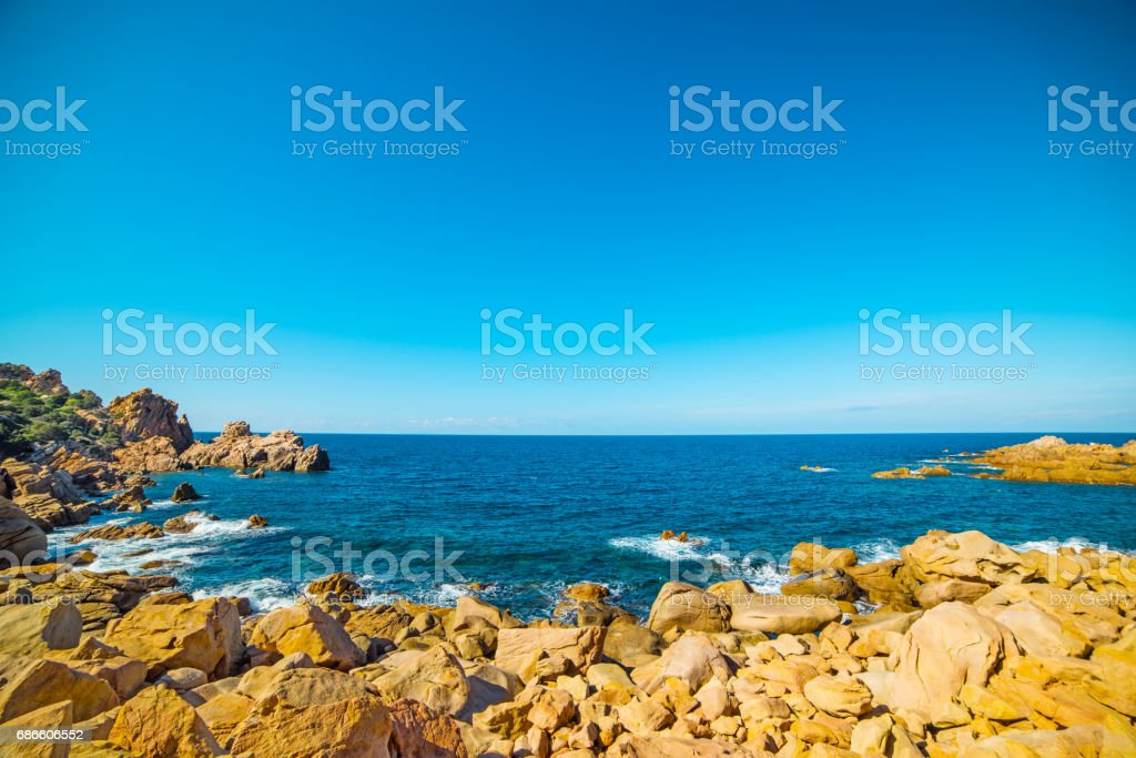 Blue sea and rocky coast royalty-free stock photo