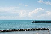 istock Blue sea and seawall 1213584663