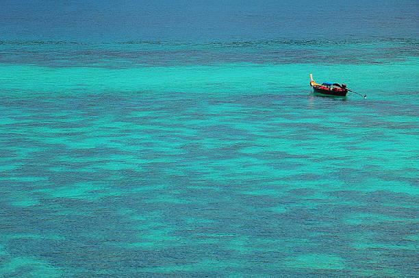 Blue  sea and white sand in Koh Lipe stock photo