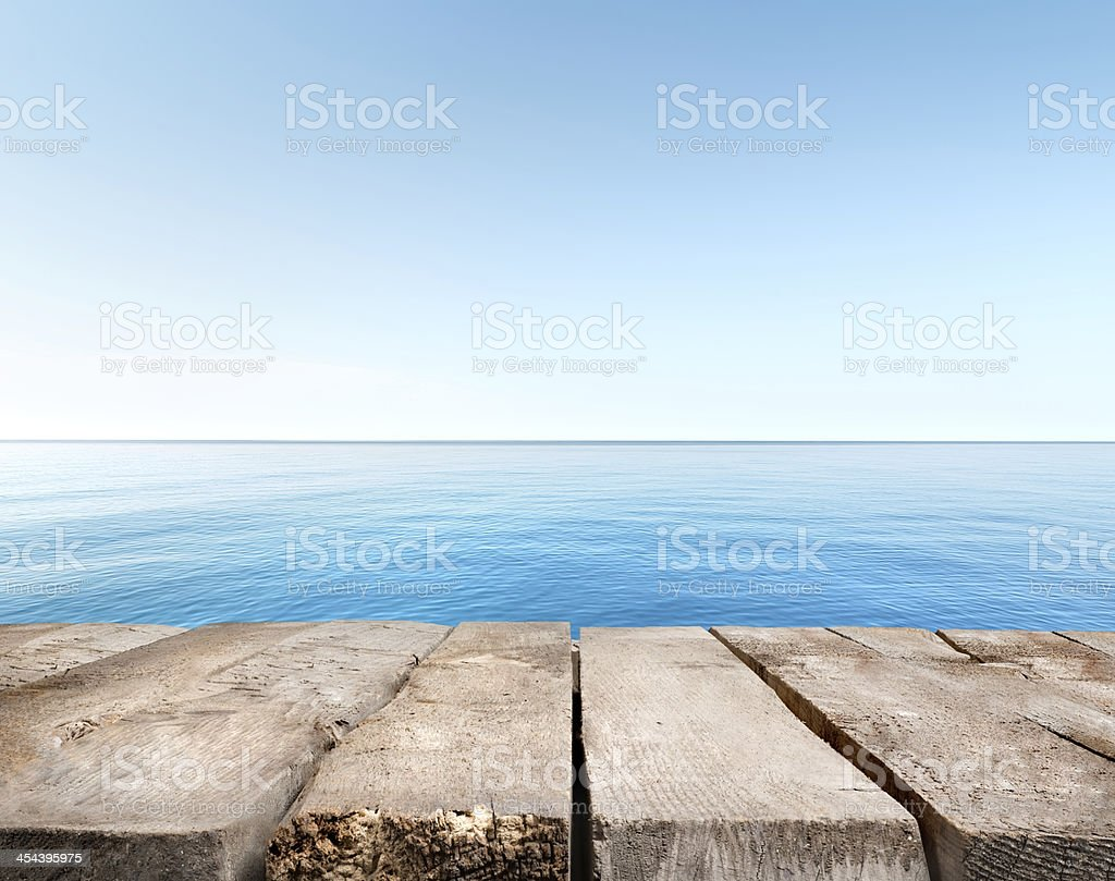 Blue sea and wooden pier stock photo