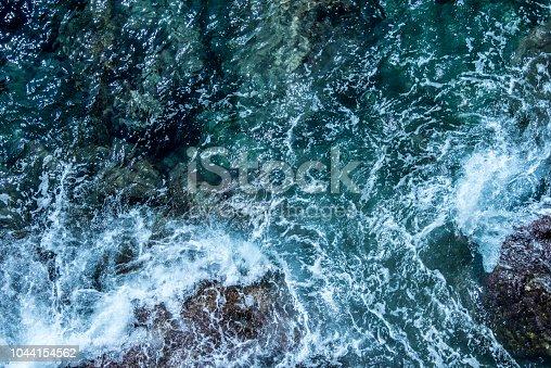 istock Blue sea foaming water background 1044154562