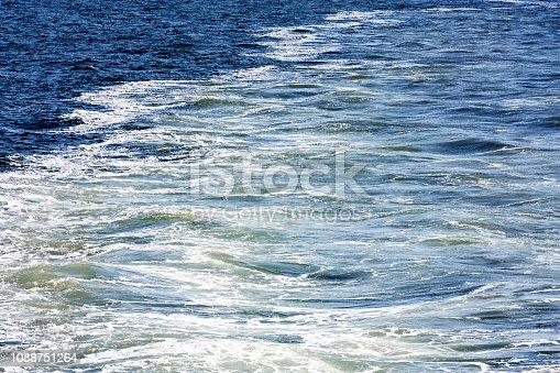 istock Blue sea foaming water background 1088751264