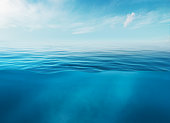 istock Blue sea or ocean water surface and underwater with sunny and cloudy sky 1197623205