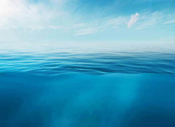 Blue sea or ocean water surface and underwater with sunny and cloudy sky Blue sea or ocean water surface and underwater with sunny and cloudy sky. ocean stock pictures, royalty-free photos & images