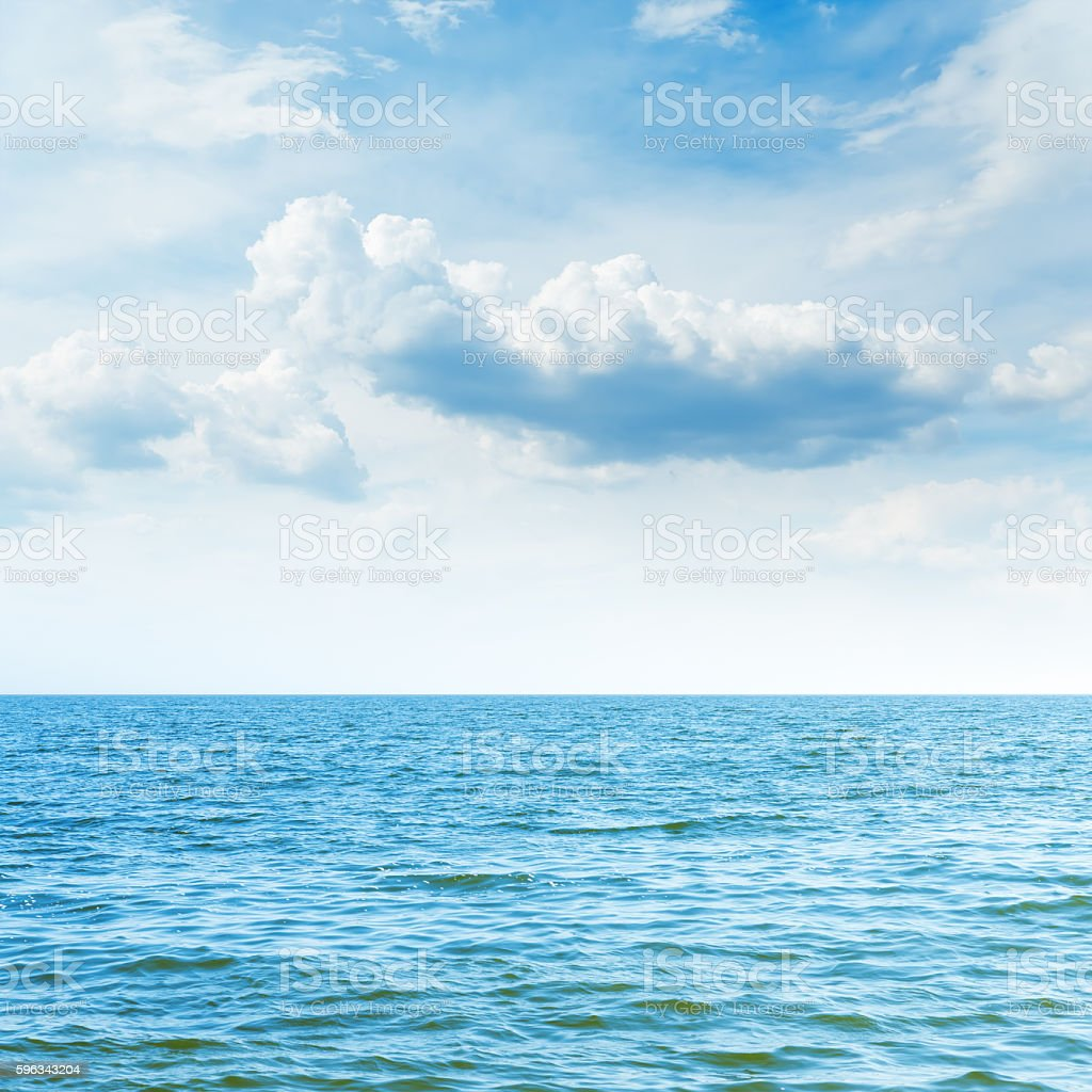 blue sea to horizon and clouds over it royalty-free stock photo