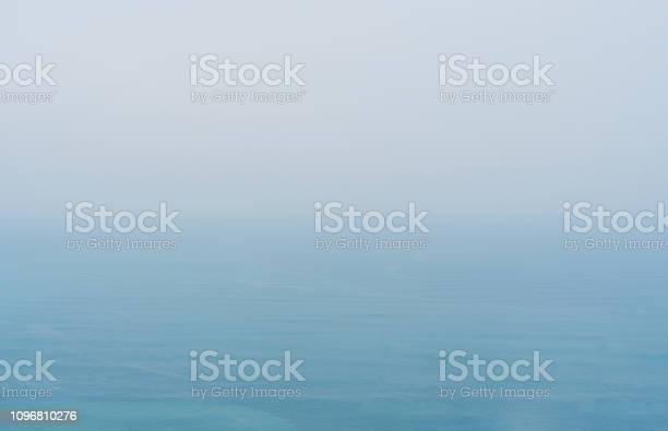 Photo of Blue sea with mist and overcast sky, mystery environment over ocean