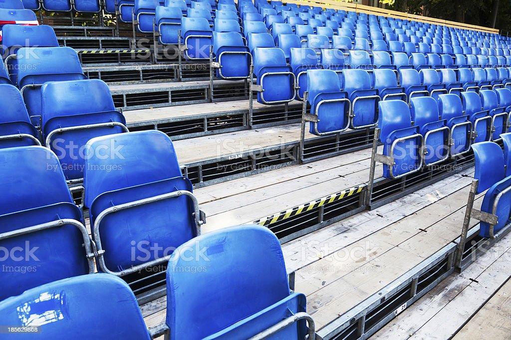 blue seats of bleachers royalty-free stock photo