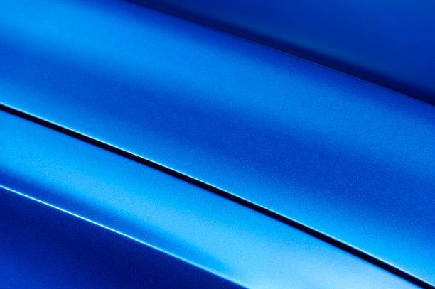 Blue sedan bodywork Surface of blue sport sedan car metal hood; part of vehicle bodywork vehicle hood stock pictures, royalty-free photos & images
