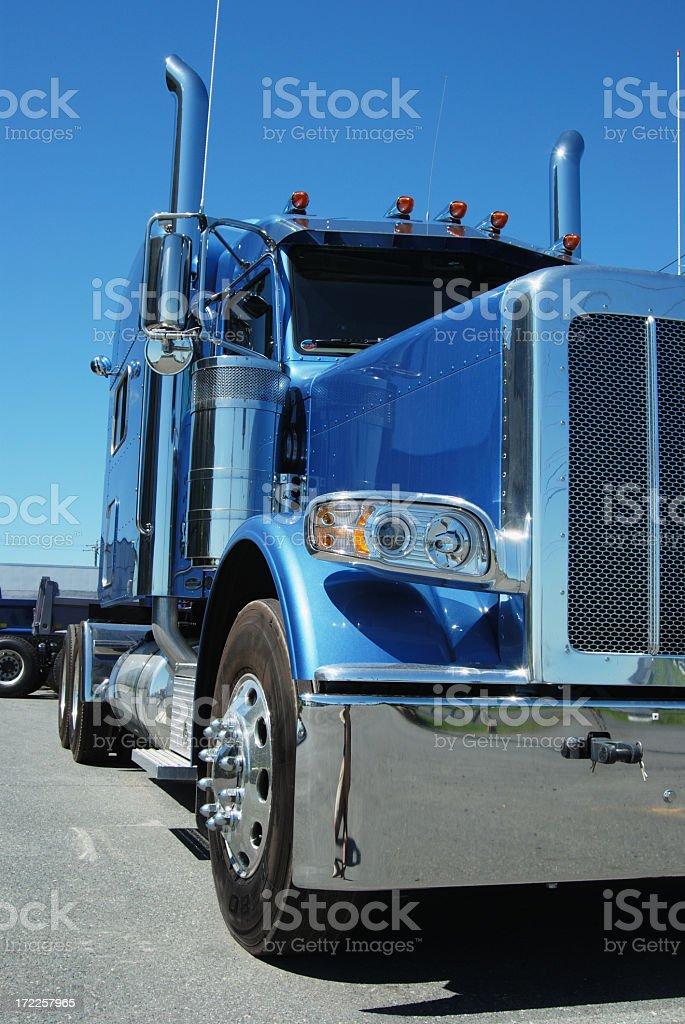 Blue semi truck with chrome bumper stock photo