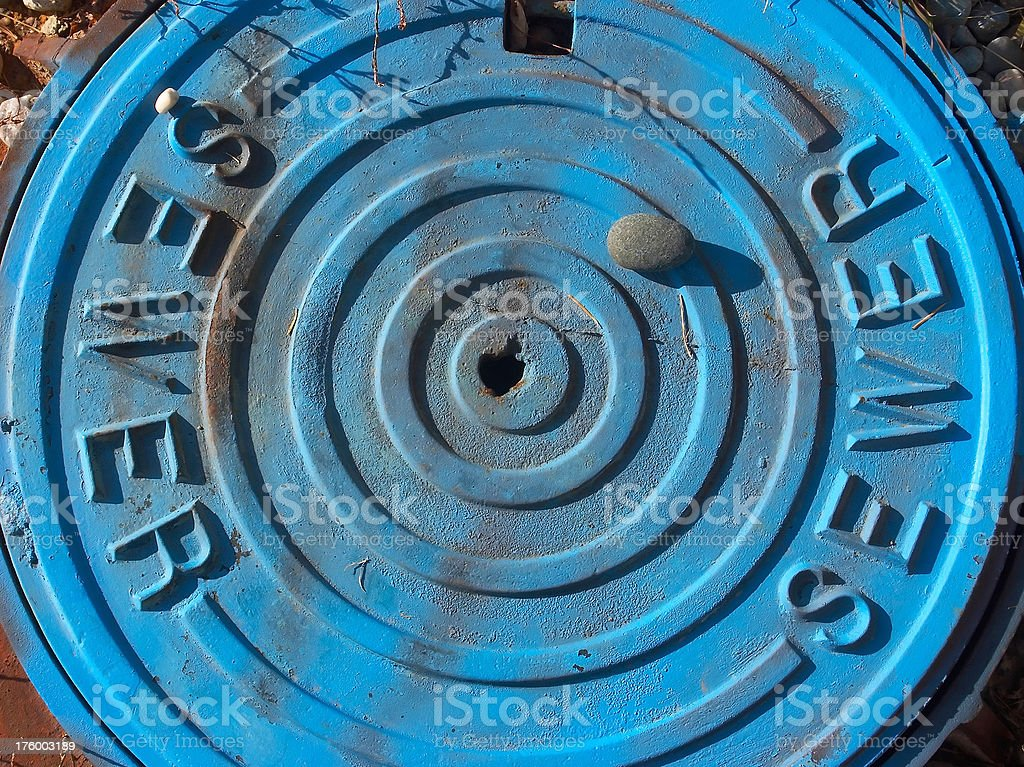Blue Sewer Lid stock photo