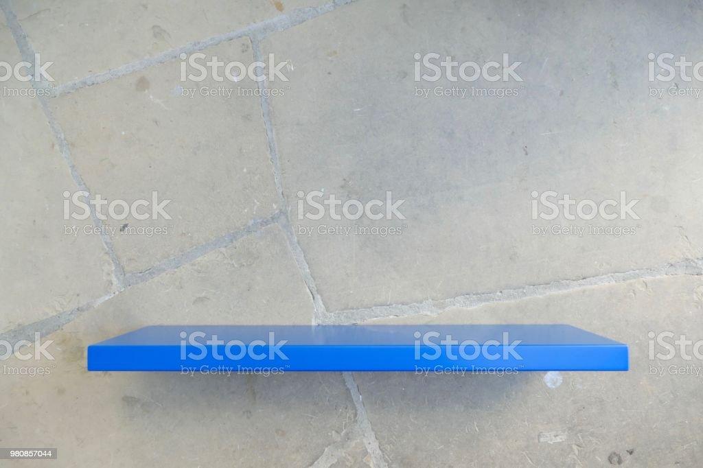 Blue shelf on concrete wall