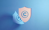 istock Blue Shield and Copyright Symbol On White Background 1189824376