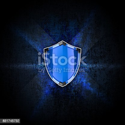 istock Blue shield with black corners on the dark rough background. 831745732