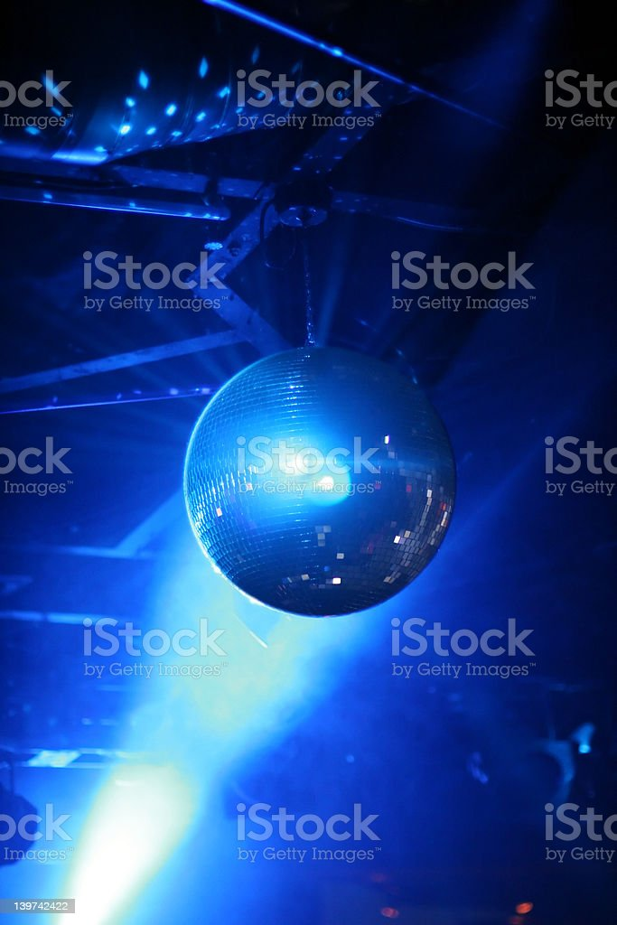 blue shining discoball / mirrorball in motion royalty-free stock photo