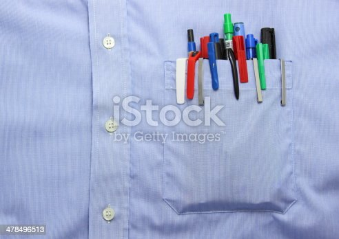 istock Blue shirt pocket with many different ballpoint pen and bottoms 478496513
