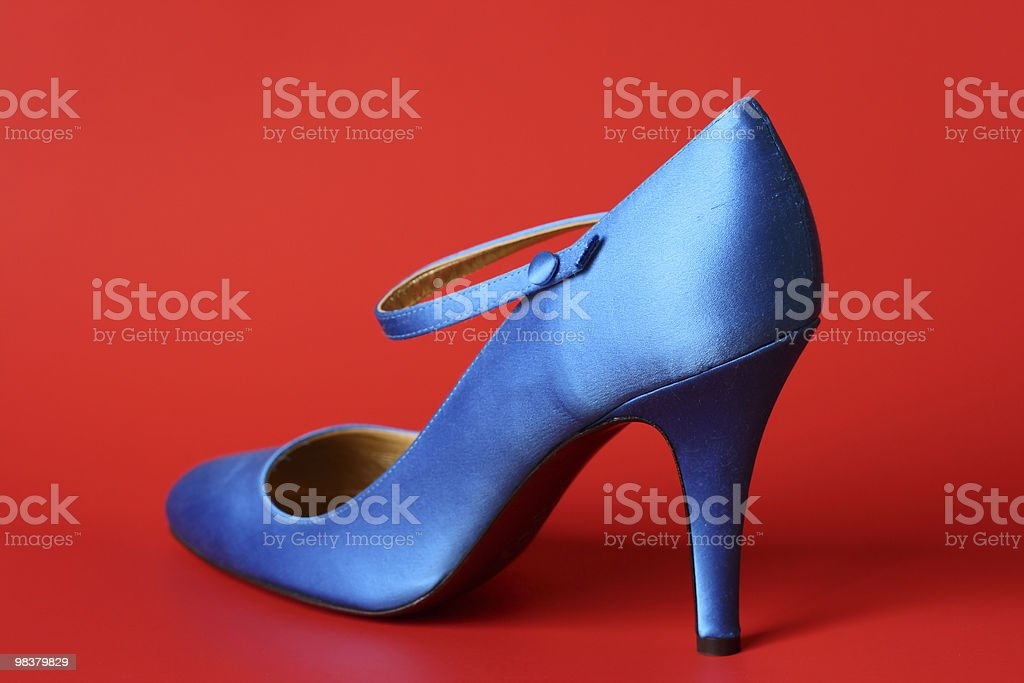 Blue shoe on red background royalty-free stock photo