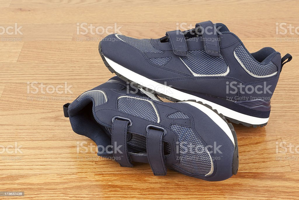 Blue Shoes on Wood Floor stock photo