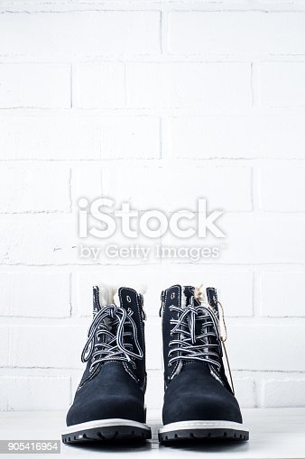 917262406 istock photo Blue shoes with tag on white background 905416954