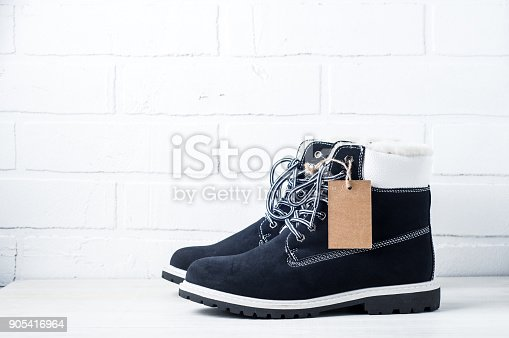 917262406 istock photo Blue shoes with tag on white background 905416964