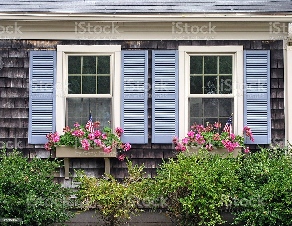 Blue shutters on home royalty-free stock photo