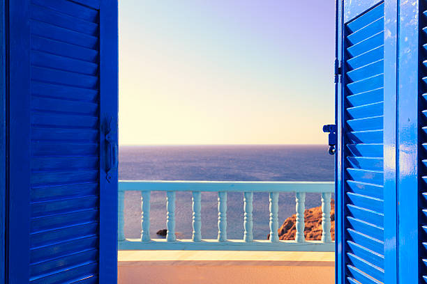 Blue Shutters Open onto Sea and Sky at Dawn