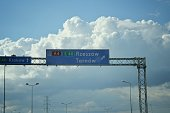 istock Blue sign on the highway indicating Tarnow and Rzeszow in Poland on circa Septemvber 2019 in A4 Road, Poland. 1193873780