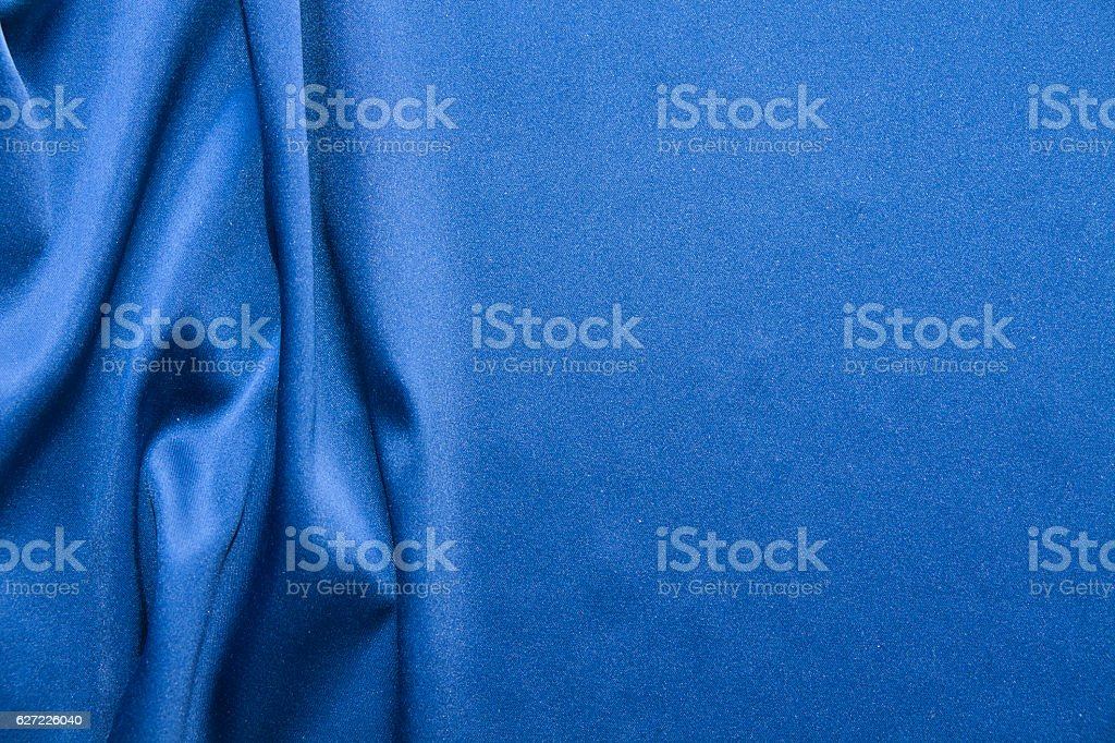 Blue silk background. Abstract wavy texture stock photo
