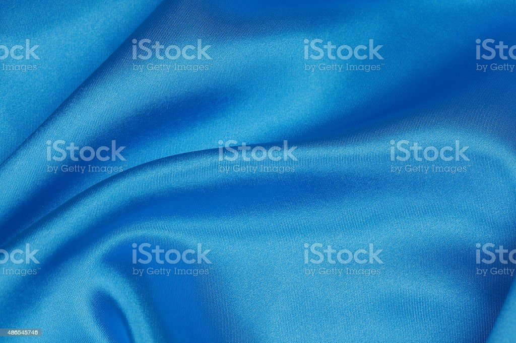 Blue Silk cloth of wavy abstract background stock photo