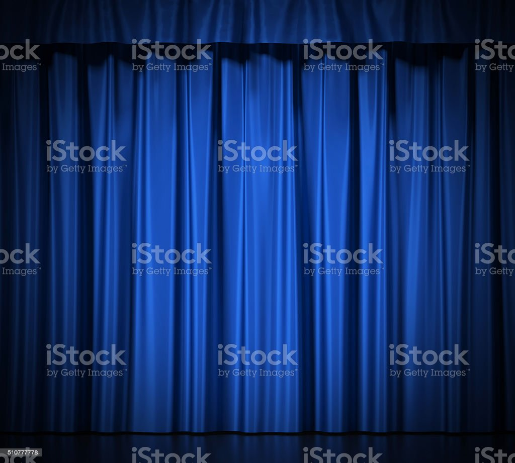 Blue silk curtains with garter isolated on white background. stock photo