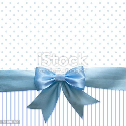 istock Blue silk ribbon and bow for background 541851592