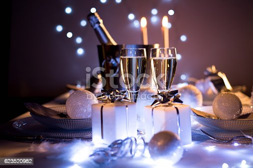 istock blue silver romantic new year eve luxury restaurant christmas table 623520982