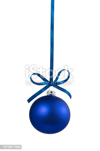 Blue christmas ball hanging on ribbon with bow, isolated on white.