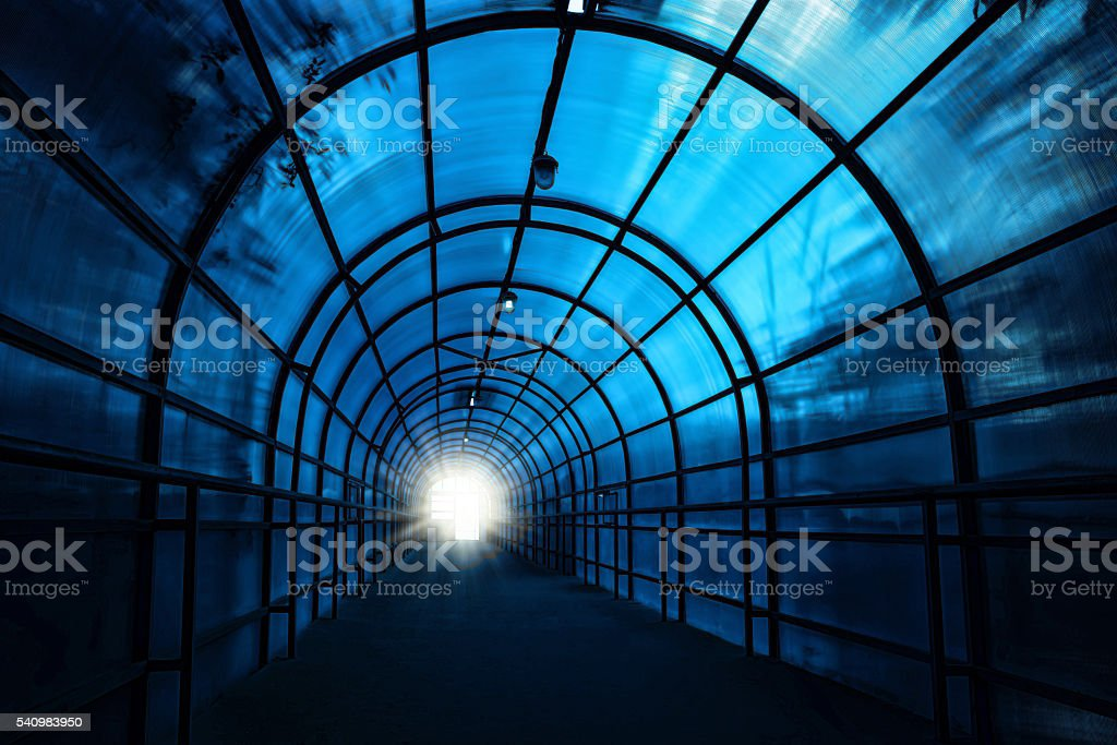 Blue sinister tunnel stock photo
