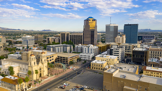 Golden light reflects off the buildings in the downtown city center of Tucson Arizona