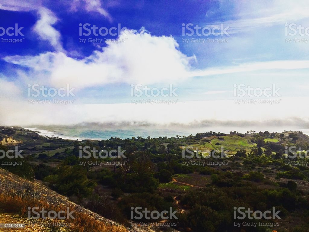 Blue Skies from the green hill. stock photo