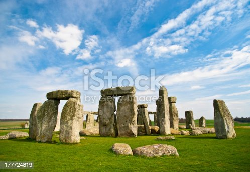 The world famous prehistoric landmark and UNESCO World Heritage Site on Salisbury Plain, Wiltshire, England. A beautiful blue sky with fluffy clouds provides copy space above while bright green grasses below grab the viewer's attention.